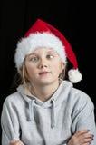 拉一个滑稽的表面的圣诞老人帽子的女孩 库存照片