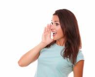 拉丁女性尖叫在她的右边 免版税库存照片