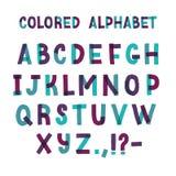 拉丁字体或装饰英语字母表由绿色和紫色橡皮膏制成 被安排的套信件  库存例证