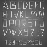 拉丁字母信件和数字 免版税库存照片