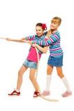 拉绳索的女孩小组 免版税库存图片