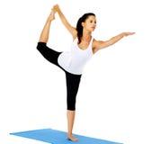 拉常设瑜伽的弓姿势 免版税库存图片