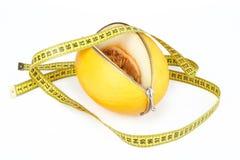 拉开拉链的瓜和测量的磁带 库存照片