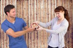 拉扯一个式样房子的夫妇的综合图象 免版税库存照片