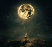 拉扯月亮 库存图片