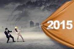 拉扯第的两个人2015年 免版税图库摄影