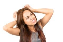 拉扯头发的沮丧的亚洲女孩脾气勃然大怒 免版税库存图片
