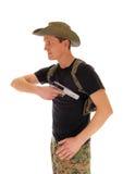 拉扯他的手枪的战士 库存照片
