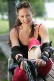 拉直排轮式溜冰鞋的女孩 库存照片
