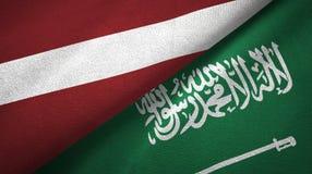 拉脱维亚和沙特阿拉伯旗子纺织品布料 库存例证