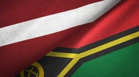 拉脱维亚和瓦努阿图两旗子纺织品布料,织品纹理 皇族释放例证