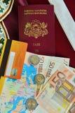 拉脱维亚状态的护照与金钱的 库存图片
