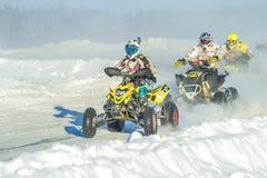 拉脱维亚, Jaunrauna,冬天摩托车越野赛,与quadracycle,镭的司机 库存图片