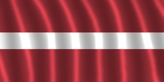 拉脱维亚FLAG-FLUTTERING 库存照片