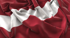 拉脱维亚旗子被翻动的美妙地挥动的宏观特写镜头射击 库存图片