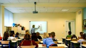 拉长的现有量查出的课程学校向量白色 在教训 免版税库存照片