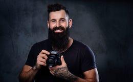 拍与一台专业照相机的一个人照片 库存图片