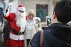 拍与圣诞老人的照片 库存图片