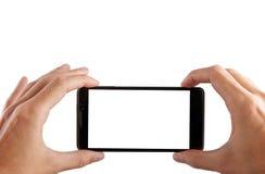 拍与流动,巧妙的电话的照片有屏幕的裁减路线的 免版税图库摄影