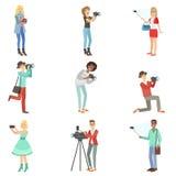 拍与照片和摄象机的人们照片 库存照片