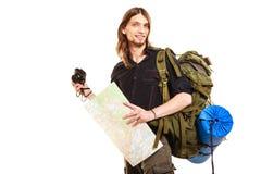 拍与照相机的人旅游背包徒步旅行者照片 图库摄影