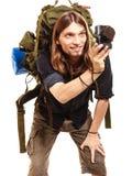拍与照相机的人旅游背包徒步旅行者照片 免版税库存图片