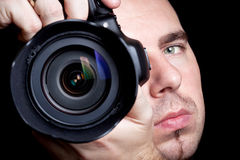 拍与DSLR的摄影师照片 免版税库存照片