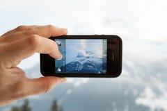 拍与iPhone的一张Instagram照片 免版税库存照片