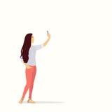 拍在巧妙的电话的剪影女孩Selfie照片 库存图片