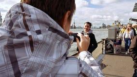 拍在河沿的两个少妇照片 库存图片