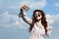 拍在移动电话照相机的女孩自画象照片 库存图片