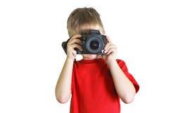 拍在photocamera的男孩照片 免版税库存照片