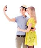 拍照片的她自己的女同性恋的夫妇与一个手机 免版税图库摄影