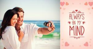 拍照片的愉快的夫妇的综合图象 库存图片