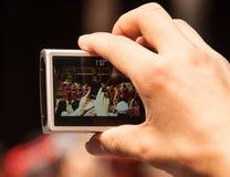 拍照片的游人 免版税库存照片