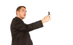 拍自已照片的中古时期人使用电话 免版税库存照片
