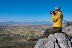拍谷的照片远足者摄影师 免版税库存照片