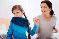 拒绝重要治疗的恼怒的小女孩 免版税图库摄影