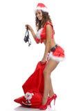 拔出从她的袋子的性感的圣诞老人女孩一件内裤 免版税库存照片