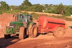 拖拉机和水Bowser 图库摄影