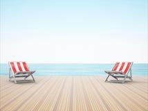 拖曳在海滩的躺椅 免版税库存图片