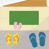 拖鞋和擦鞋垫在门例证前面 免版税库存照片