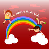 招呼愉快的孩子使用在彩虹和新年快乐 免版税图库摄影