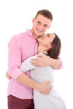 拥抱一对年轻的夫妇一起站立和 库存照片
