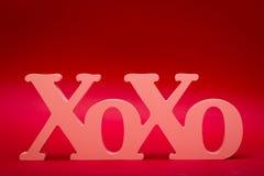 拥抱和亲吻符号 免版税库存照片