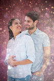 拥抱和微笑对彼此的逗人喜爱的夫妇的综合图象 库存图片