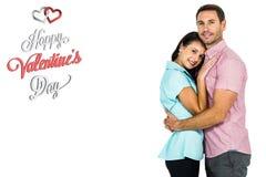 拥抱和看照相机的微笑的夫妇的综合图象 免版税库存图片