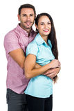拥抱和看照相机的微笑的夫妇 免版税库存图片