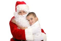 拥抱圣诞老人 免版税库存照片