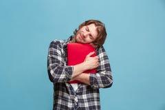 拥抱在蓝色的商人膝上型计算机 图库摄影